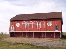 Red barn with Pennsylvania dutch hex sign. A rural red barn with Pennsylvania dutch hex signs stock photo