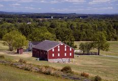Red Barn with Railroad Tracks Stock Photo