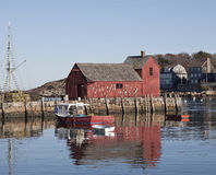 Red barn at Rockport, MA. A red barn in the harbor of Rockport MA, a very exposed spot at the Atlantic ocean Stock Photo