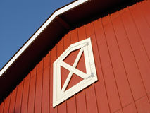 Red Barn Roof. View looking up at the top of a red barn with blue sky background Royalty Free Stock Photo