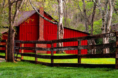 Red Barn. Rural area barn in trees stock image