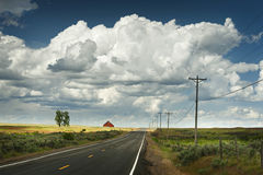 Red Barn and Rural Highway Royalty Free Stock Image