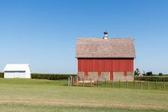Red barn in rural Iowa on a cloudless summer day. stock photo