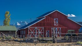 Red Barn with San Juan Mountains in background outside of Ridgwa. OCTOBER 3, 2017 - Red Barn with San Juan Mountains in background outside of Ridgway, Colorado Royalty Free Stock Image