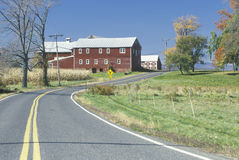 A red barn and scenic route 9G in the Hudson River Valley, NY Royalty Free Stock Images