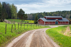 Red barn in scenic rural landscape royalty free stock images