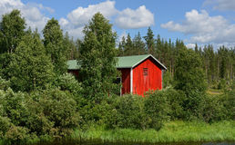 Red Barn on the shore Royalty Free Stock Images