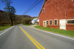 Red barn by side of Scenic Route 100 in autumn, VT Stock Photos