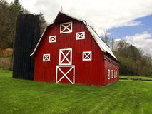 Red barn and silo Stock Images