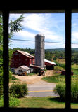 Red barn and silo. Old red barn and silo, with farm equipment. Taken in rural Pennsylvania royalty free stock photo