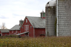 Red barn and silo with cloudy sky Stock Image