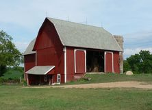 Red Barn with Silo in Midwest Stock Images