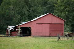 Red barn. A red barn sits waiting for the cows to come home Royalty Free Stock Image