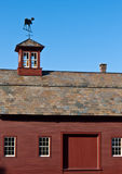 Red Barn with slate roof and cupola Stock Images