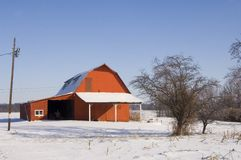 Red barn and snow Stock Images
