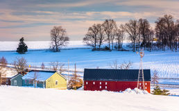 Red barn and snow-covered farm fields in rural York County, Penn Stock Images