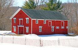 Red barn and snow fence, winter upstate NY Stock Photos