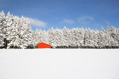 Red barn in snow landscape Royalty Free Stock Image