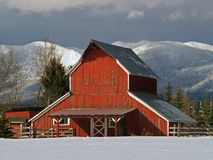 Red Barn and Snowy Mountains Royalty Free Stock Photos
