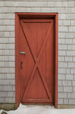 Red barn style door on cedar shakes shingles background Stock Photos