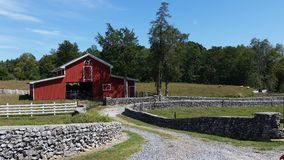 Red barn Tennessee. Red horse barn Tennessee stone wall around farm Royalty Free Stock Photos
