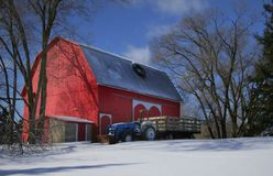Red barn and tractor Royalty Free Stock Images