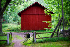 Red barn trees gate fence Royalty Free Stock Photography