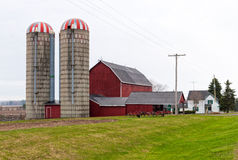 Red barn and two silos Stock Photography