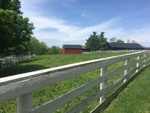 Red Barn With White Fence Stock Images