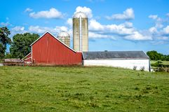 Red Barn, White Outbuilding and Two Silos stock photos
