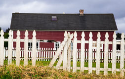 Red Barn with white picket fence Stock Photography