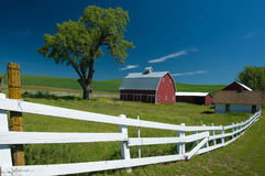 The Red Barn and white picket fence in Palouse WA Stock Image