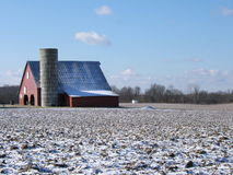 Red barn in winter. Snowy red barn Royalty Free Stock Image