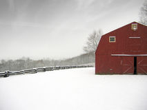 Red barn in winter. Red barn on a snowy farm Stock Photos