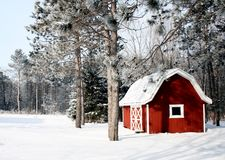 Red barn on a winter background royalty free stock images