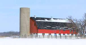 Red barn in a winter landscape. A Red barn in a winter landscape Stock Photos