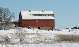 A Red Barn in Winter Landscape Royalty Free Stock Photography