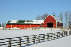 Red Barn in Winter Snow. Red wooden country barn in the winter snow stock photography