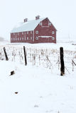 Red Barn in Winter Storm Royalty Free Stock Photos