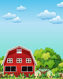 A red barnhouse near the trees Stock Photography