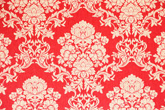 Red baroque wallpaper background. Red and golden baroque wallpaper with floral ornaments Stock Photo
