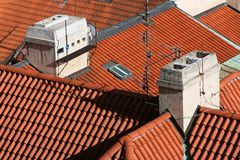 Red Barrel Tile Roofs. Many houses with Spanish style red barrel tile roofs Stock Images