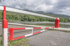 Red Barrier Gate with mountain and lake  background Stock Photos