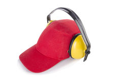 The red baseball cap with noise headphones isolated on white Stock Photo