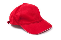 Red Baseball Cap. Plain red baseball cap isolated on a white background royalty free stock images