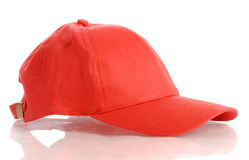 Red baseball hat. Red baseball cap or hat isolated on white background Royalty Free Stock Photos