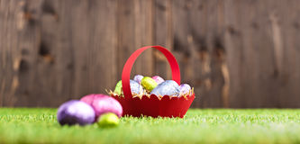 Red basket with Chocolate Easter eggs Stock Images