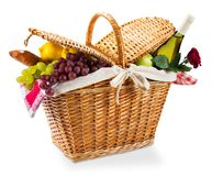 Wicker picnic basket with a red gingham cloth on a. Red basket picnic wicker gingham color group Stock Photography