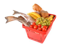 Red basket with products. The red basket with products costs on a table Royalty Free Stock Image