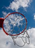 New Basketball hoop shot from below with clouds against blue sky Royalty Free Stock Photos
